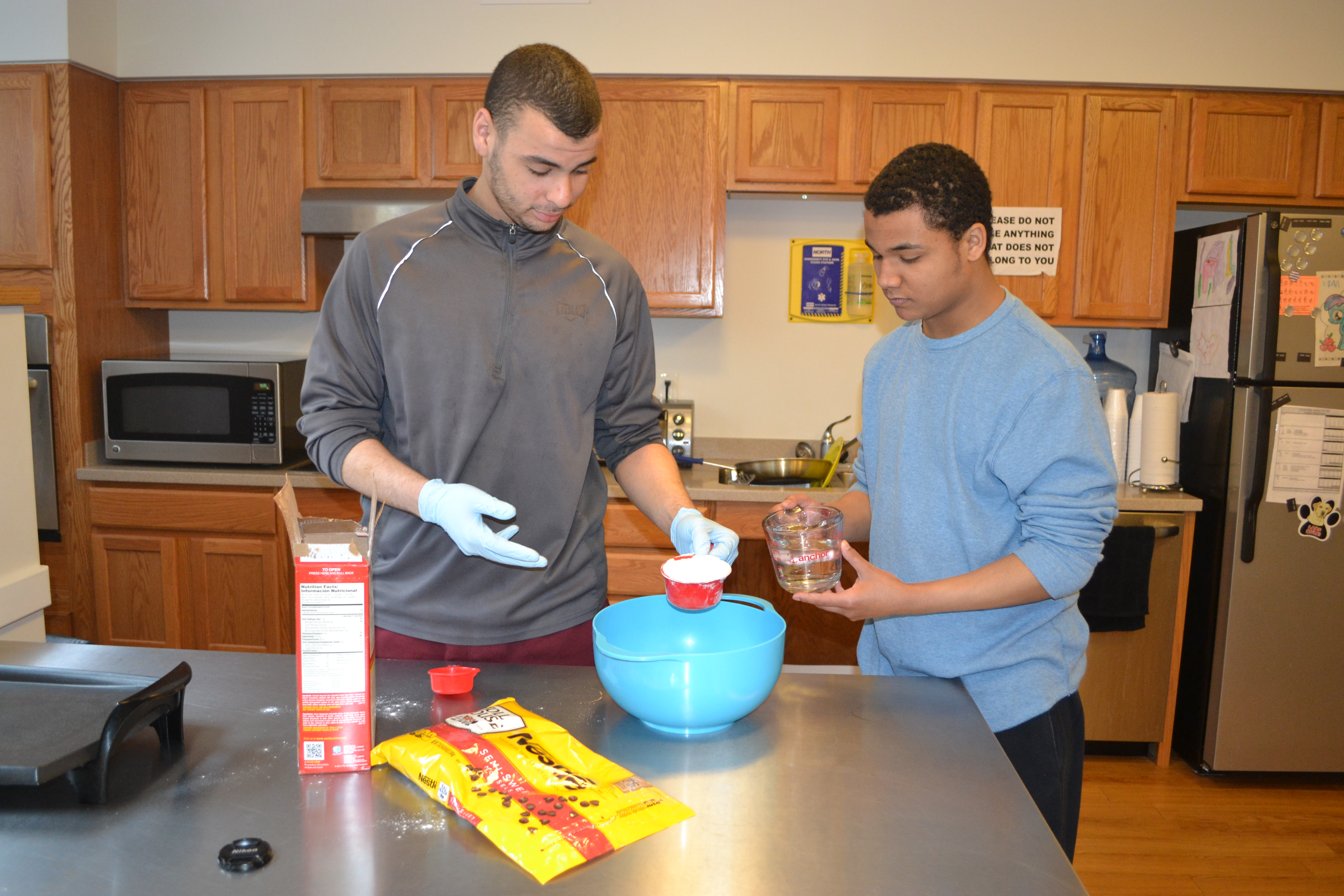 Two young men cooking together