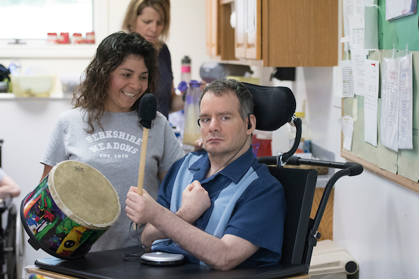 man with disability playing drum