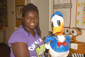 student with donald duck