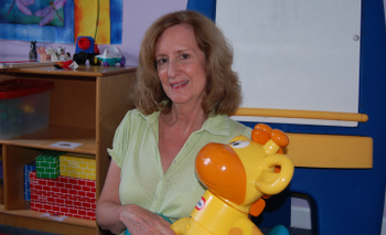 Nancy holding children's toy