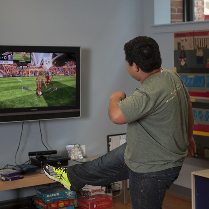 young adult playing a video game