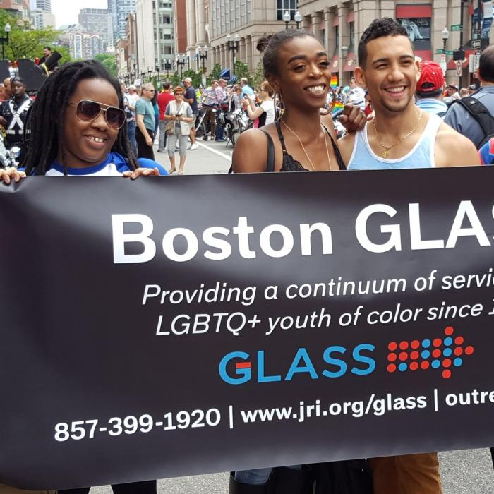 Young adults holding banner