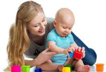 Mother and child playing with blocks.