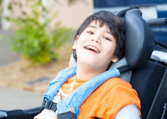 smiling boy in wheel chair