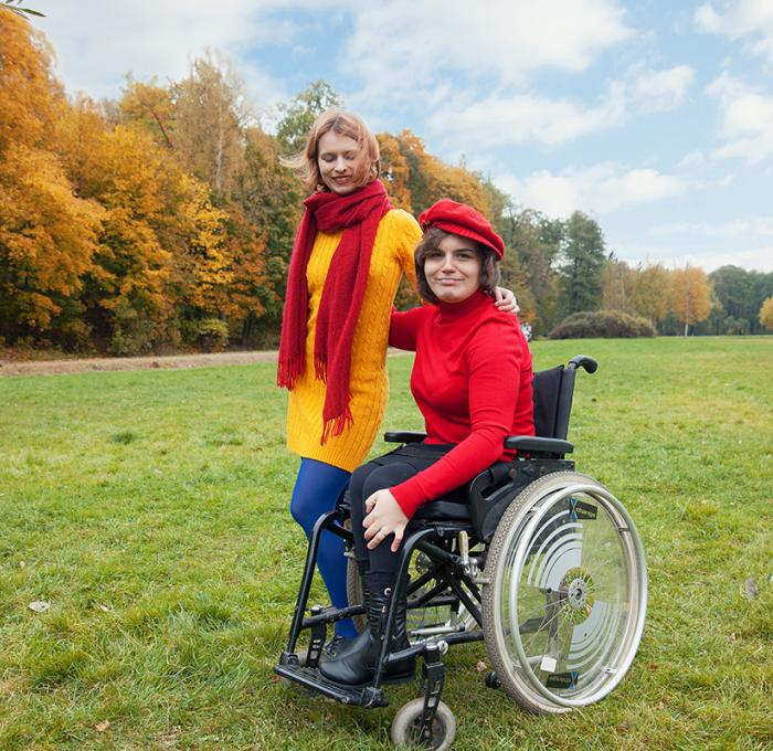 female in wheel chair with a friend